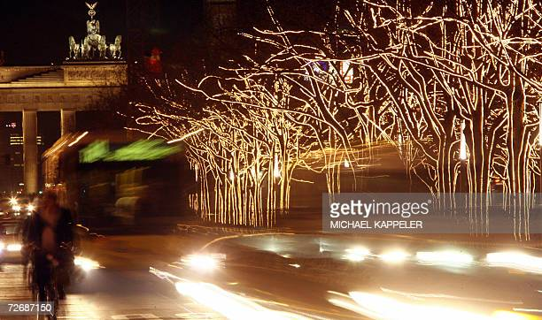 Trees at Berlin's Unter den Linden boulevard in front of the Brandenburg Gate are decorated for Christmas 30 November 2006 More than three weeks...