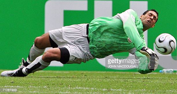Tunisian goalkeeper Ali Boumnijel dives to make a save in the opening round Group H World Cup football match Ukraine vs Tunisia 23 June 2006 in...