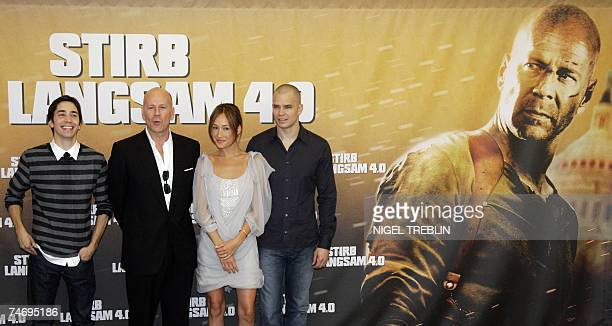 US actor Bruce Willis poses for photographers 18 June 2007 during a photo call for his latest film Live Free or Die Hard the 4th of the Die Hard...