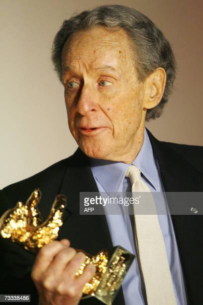 Veteran US director Arthur Penn holds his Honorary Golden Bear award after receiving the trophy at the 57th Berlinale International Film Festival in...
