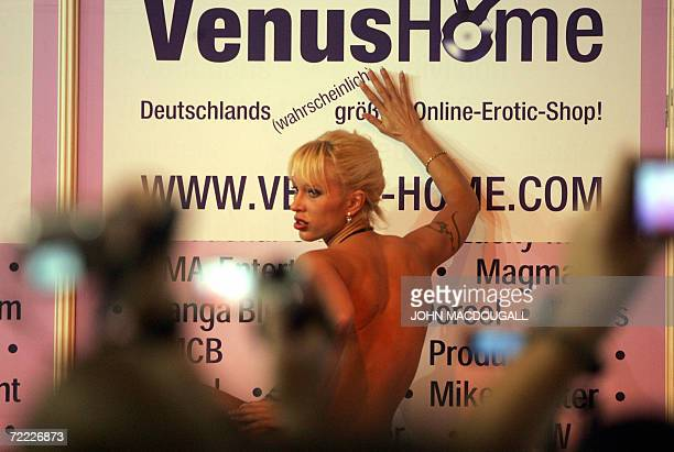 Visitors film a live porn show at the 10th Venus International Erotic Trade Fair in Berlin 20 October 2006 The fair runs until 22 October AFP PHOTO...