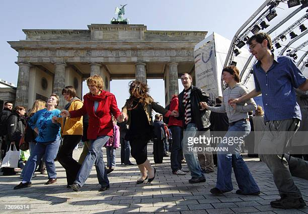 Visitors to the European Festival dance in front of the stage near Berlin's Brandenburg Gate 25 March 2007 in Berlin on the occasion of the 50th...