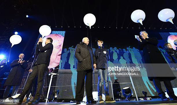 Berlin governing Mayor Klaus Wowereit applauds as last Soviet leader Mikhail Gorbachev waits prior to releasing a balloon during a Street Party...