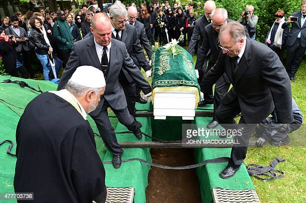 Berlin Imam Abdallah Hajjir directs pallbearers carrying the coffin of an unidentified Syrian refugee who died while making his way to Germany during...