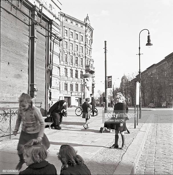 Berlin in the postwar period Children playing on the street at the Rathenower Straße at the corner to Perleberger Straße Photographer Ernst Hahn