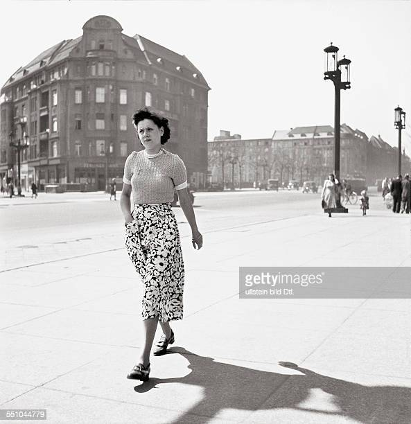 Berlin in the postwar period Street scene at the Kaiserdammbrücke in the back ground the Messedamm in the front view a walking woman Photographer...