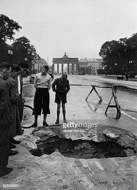 Berlin in World War II bomb crater on the EastWestAxis close to the Brandenburg Gate