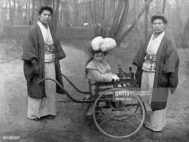 Japanese nannies with a girl sitting in a rickshaw published in 1908