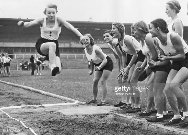 Berlin long jump of a member of the 'League of German Girls' at a national sports festival of the Hitler Youth