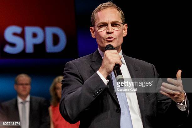 Berlin Mayor and German Social Democrat Michael Mueller greets supporters following initial exit poll results in Berlin state elections on September...