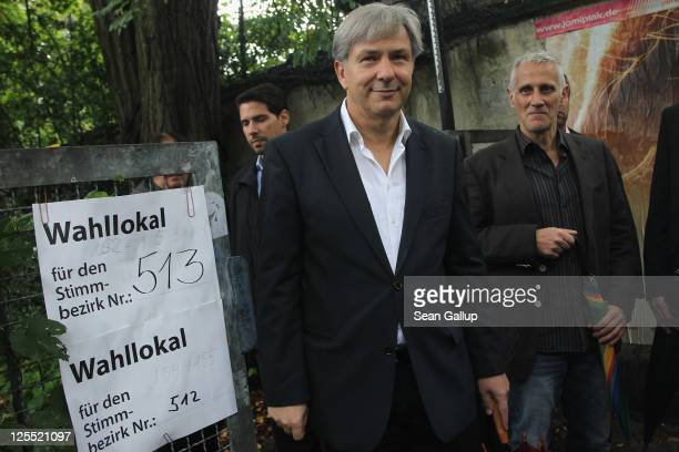 Berlin mayor and incumbent candidate of the German Social Democrats Klaus Wowereit and his partner Joern Kubicki depart after casting their ballots...