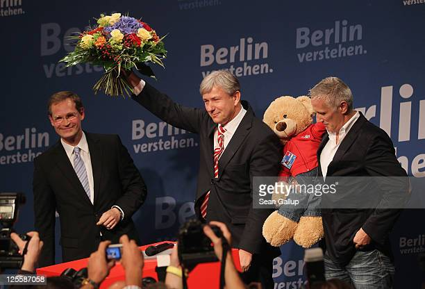 Berlin Mayor and incumbent candidate of the German Social Democrats Klaus Wowereit celebrates with his partner Joern Kubicki and Berlin regional SPD...