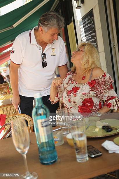 Berlin Mayor Klaus Wowereit greets an acquaintance during a walking tour in Charlottenburg district on August 6 2011 in Berlin Germany Wowereit a...
