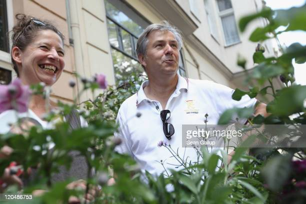 Berlin Mayor Klaus Wowereit greets plants and flowers seller during a walking tour in Charlottenburg district on August 6 2011 in Berlin Germany...