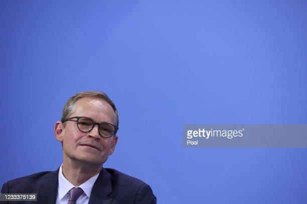 Berlin mayor Michael Müller attends a joint press conference with Chancellor of Germany Angela Merkel and Bavaria's State Premier Markus Soeder after...