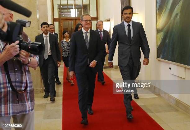 Berlin Mayor Michael Mueller and the Emir of Qatar Sheikh Tamim bin Hamad Al Thani arrive for talks at Mueller's office at City Hall on September 6...