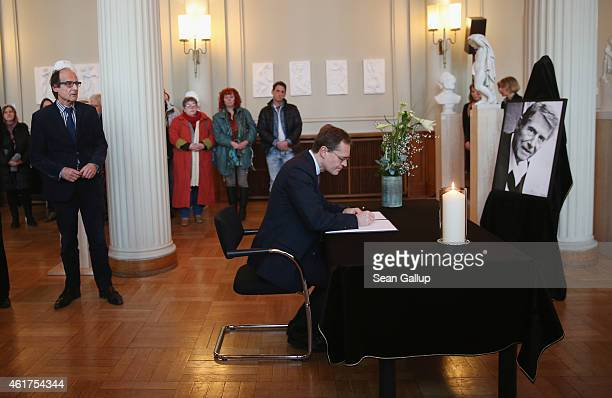 Berlin Mayor Michael Mueller signs a book of condolences for Austrianborn singer and entertainer Udo Juergens as Juergens's brother Manfred...
