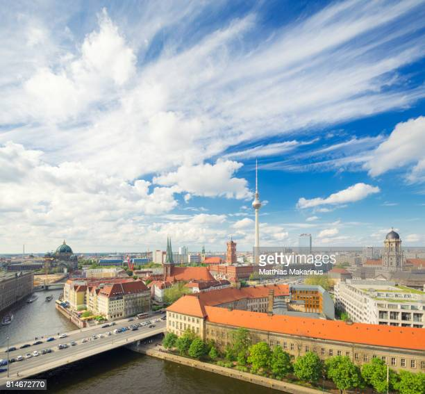 berlin modern urban skyline city with traffic and clouds - makarinus stock photos and pictures