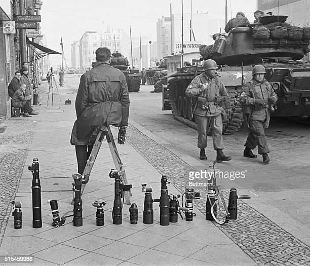 News photographers cameras and lenses are lined up on the sidewalk near the Friedrichstrasse crossing point October 28 1961 during duel of nerves...