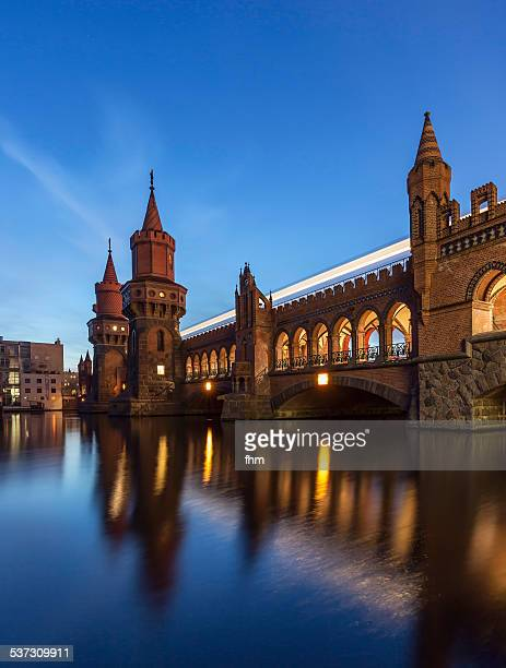 berlin - oberbaumbrücke with light trail - friedrichshain stock photos and pictures