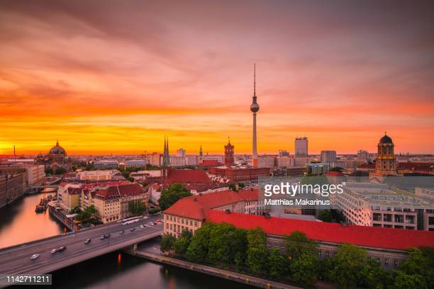 berlin panorama summer sunset skyline with tv tower - makarinus stock photos and pictures