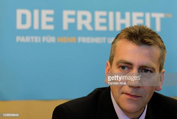 Berlin parliamentarian Rene Stadtkewitz speaks to the media to announce the creation of a new right ofcenter political party at Belair hotel on...