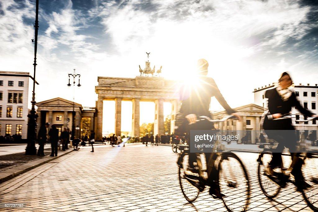 Berlin - People cycling at Brandenburg Gate : Stock Photo