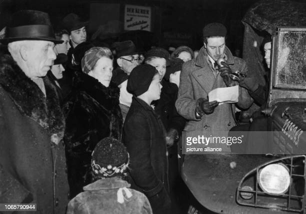 Berlin people listen to a radio broadcast concerning the currency reform through a radio car of the RIAS on 20th March 1949 | usage worldwide