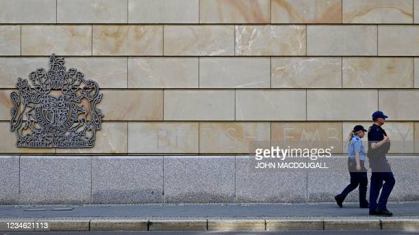 Berlin police officers walk in front of the British Embassy in Berlin on August 11, 2021. - A British man suspected of spying for Russia in exchange...