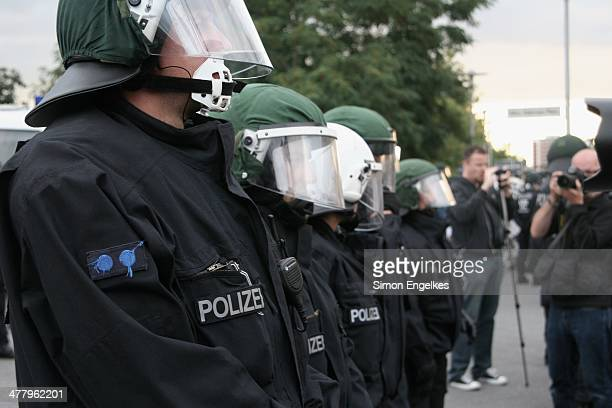 Berlin police protecting a demonstration of the German Nationalist Party against refugee reception in Berlin-Hellersdorf. The people in front of the...