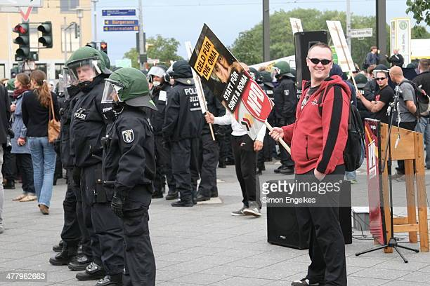 CONTENT] Berlin police protecting a demonstration of the German Nationalist Party against refugee reception in BerlinHellersdorf August 2013