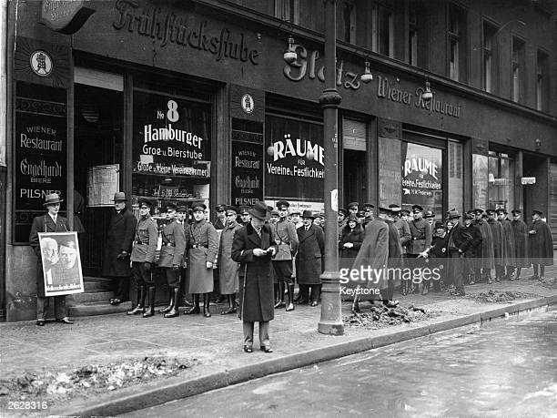 Berlin Police wait outside a polling booth in Berlin before going to cast their vote in the election Nazis gained a majority in the Reichstag At left...