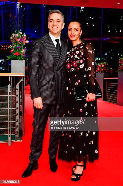 Berlin politician and member of the German Social Democrats party Sawsan Chebli and her husband Nizar Maarouf pose on the red carpet for the opening...
