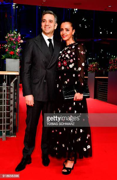 Berlin politician and member of the German Social Democrats Sawsan Chebli and her husband Nizar Maarouf pose on the red carpet for the opening...