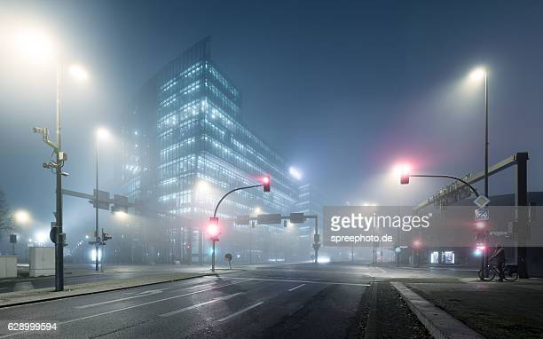 berlin potsdamer platz at foggy night - boulevard stock pictures, royalty-free photos & images