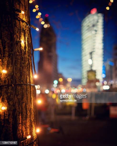 berlin potsdamer platz with bokeh and lights - focus on foreground stock pictures, royalty-free photos & images