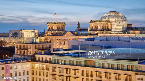 berlin, reichstag building and german chancellery - german chancellery stock pictures, royalty-free photos & images