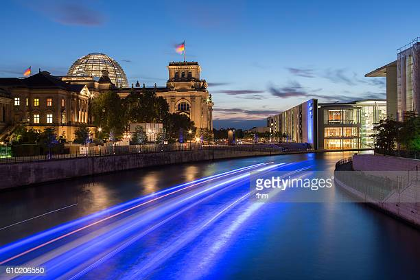 Berlin - Reichstag building/ german parliament building at a beautyful blue hour with light trails of a boat