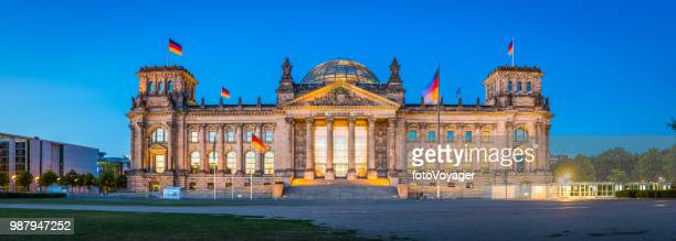 berlin reichstag german parliament building bundestag illuminated dusk panorama germany - bundestag stock pictures, royalty-free photos & images