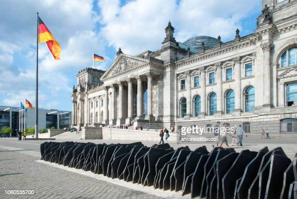 berlin - reichstag german parliament building (diagonal perspective) - monetary policy stock pictures, royalty-free photos & images