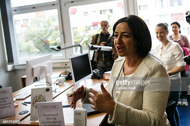 Berlin Senator for Work Integration and Women Dilek Kolat visits the opening of a new city welcome center for immigrants on August 18 2016 in Berlin...