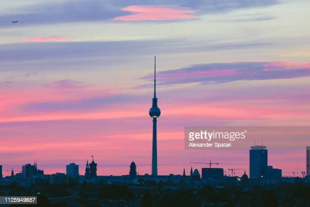 berlin skyline at sunset with berlin tv tower, germany - berlin stock pictures, royalty-free photos & images
