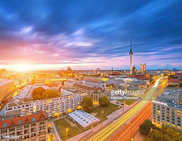 Berlin skyline cityscape with traffic and sunset