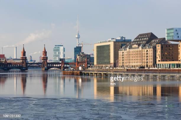"berlin skyline ""mediaspree"" with famous oberbaumbrücke and television-tower (kreuzberg-friedrichshain, berlin, germany) - friedrichshain stock photos and pictures"