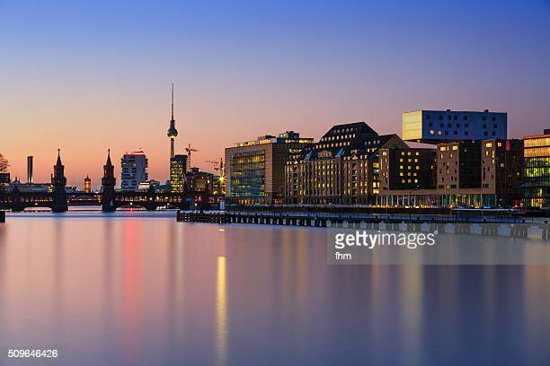 Berlin skyline near Spree river in colorful sunset