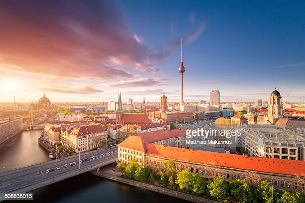 berlin skyline summer panorama with sun - makarinus stock photos and pictures