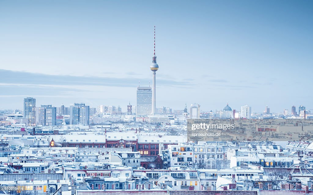 Berlin skyline with snow on the roofs : Stock Photo