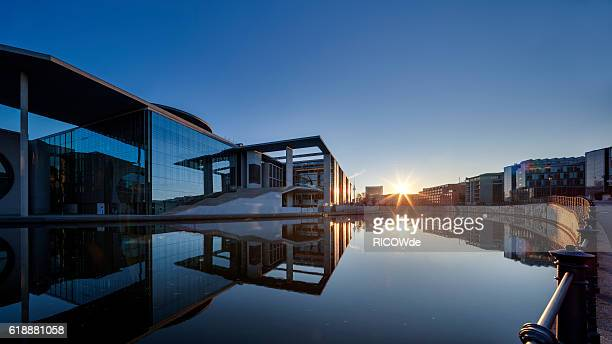 berlin spree river in government district at sunset