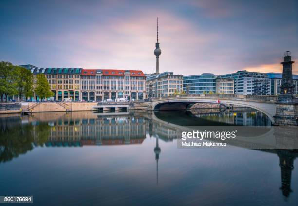 berlin spree skyline in a cloudy sunset - central berlin stock photos and pictures