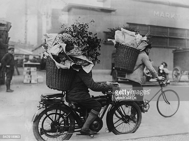 Berlin street scenes Flowers are being transported by bikes and motorbikes to the flower wholesale market in Berlin 1928 Published by 'Tempo' Vintage...